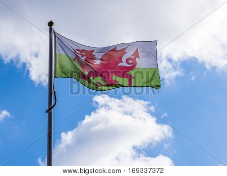 Welsh Flag flying in the wind, against a blue summers sky