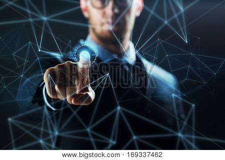 business, people, future technology, virtual reality and cyberspace concept - close up of businessman in suit working with network hologram over dark background