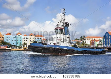 Tugboat in colorful harbor of Willemstad on Curacao