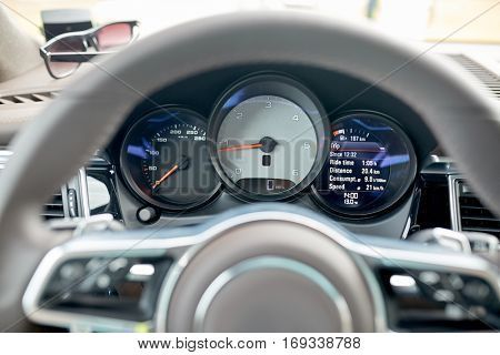 transport, road trip, drive and technology concept - close up of car dashboard with speedometer and tachometer