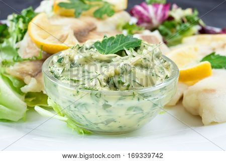 fresh homemade tartar sauce with steamed fish and parsley