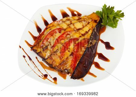 Baked Eggplant With Tomatoes And Cheese On Plate On White Background