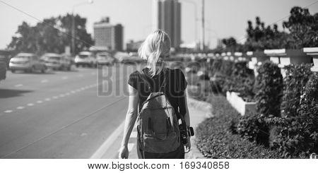 Women Walking Streetside Caucasian Camera Traveler Concept