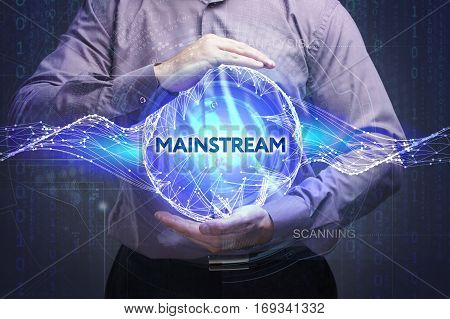 Business, Technology, Internet And Network Concept. Young Businessman Shows The Word: Mainstream