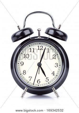 Five O' Clock On Alarm Clock Isolated On White
