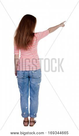 Back view of  pointing woman. beautiful redhaired  girl . girl shows something to someone. Isolated over white background. Girl in a white T-shirt points a finger at something interesting
