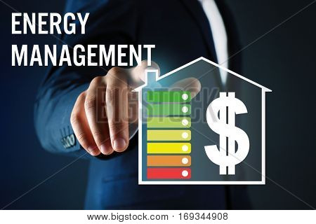 Man pushing button on virtual screen. Text ENERGY MANAGEMENT on background