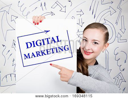 Young woman holding whiteboard with writing word: digital marketing. Technology, internet, business and marketing