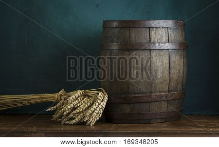 Beer barrel on table on wooden background.
