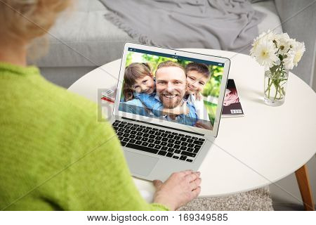 Video call and chat concept. Senior woman video conferencing on laptop