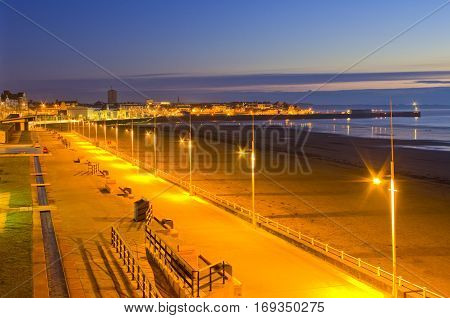 Bridlington South Bay and Harbour Sunrise over the South Bay and Harbour at Bridlington, East Riding of Yorkshire. Flamborough Lighthouse can be seen above the light on the end of the pier.