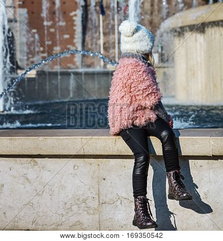 Child Near Sforza Castle In Milan, Italy Looking At Fontain