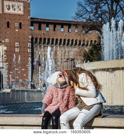 Mother And Daughter Tourists Near Sforza Castle, Milan Kissing