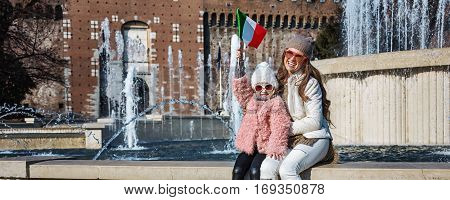 Mother And Child Tourists Near Sforza Castle Rising Flag