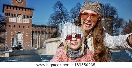 Happy Mother And Child Travellers In Milan, Italy Taking Selfie