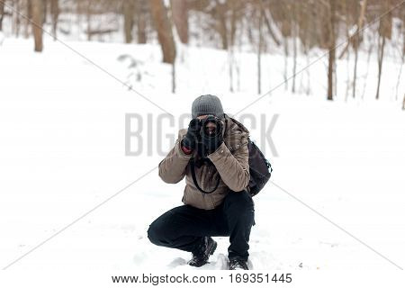 Photographer Taking Pictures In The Forest In Winter