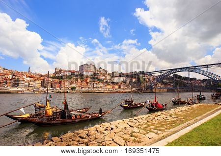 Douro River And Traditional Boats With Wine Barrels In Porto, Portugal