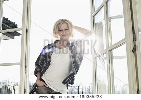 Portrait of beautiful mid-adult woman at home