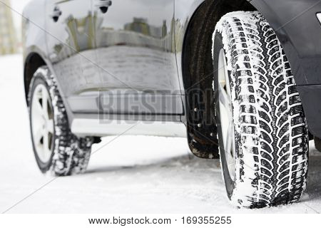 Winter tires wheels installed on suv car outdoors