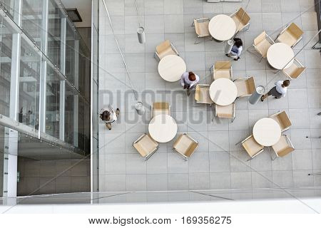 High angle view of businesswomen walking at office canteen