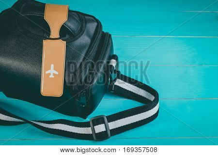 Close Up Of Blank Luggage Tag Label On Camera Bag Or Photographer Bag With Travel Insurance. Travel