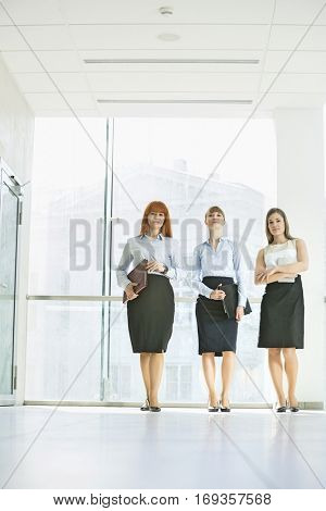Full-length of confident businesswomen standing in office