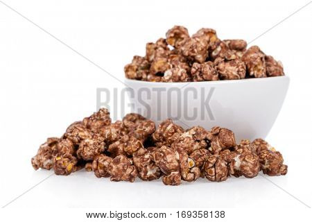 Popcorns flavored with sweet chocolate and mint in a bowl isolated on white background