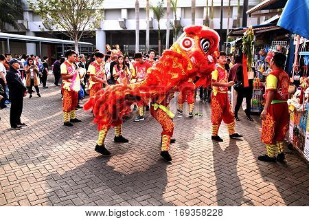 HONG KONG - FEBRUARY 05, 2017 - Crowd of asian people assist to the typical dragon dance