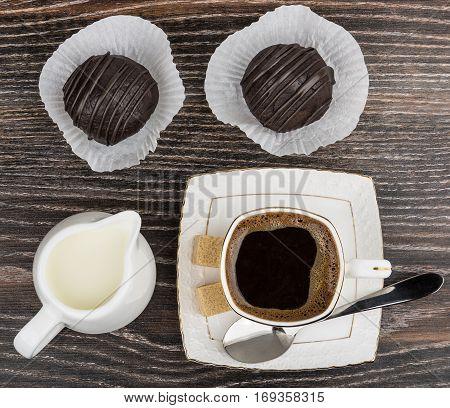 Cup Of Coffee, Jug Milk, Two Cake And Lumpy Sugar