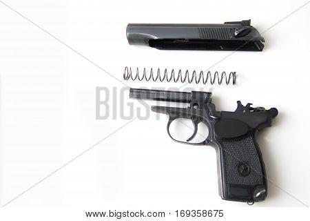 makarov system pistol disassembled on white background