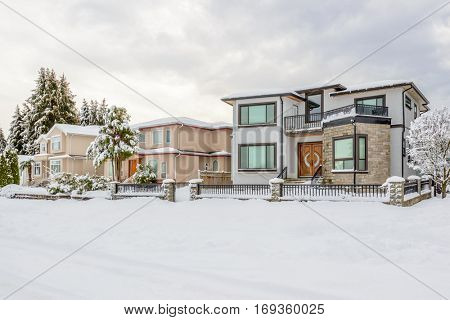 A perfect neighborhood. Houses in suburb at snow winter in the north America.