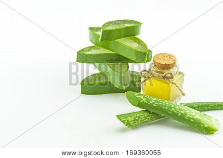 Slice Aloe Vera (Aloe barbadensis Mill.Star cactus Aloin Jafferabad or Barbados) and Aloe vera essential oil isolated on white background.