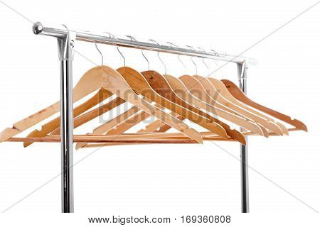 lot of wooden empty hangers for clothes on rack on white background. you have nothing to wear. sale