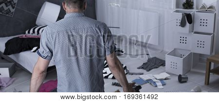 Man In A Devastated Apartment