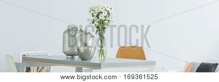 Silver home decoration on communal white table