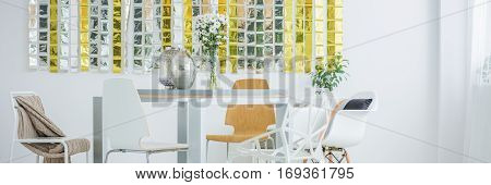 Communal table in bright modern room interior