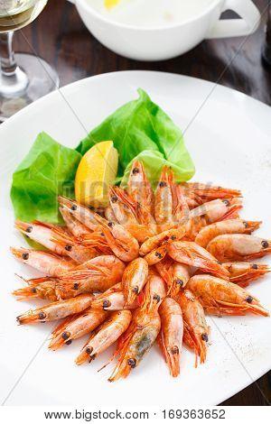 Fried shrimps on a plate with lemon