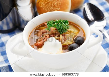 Bowl of delicious soup on a table