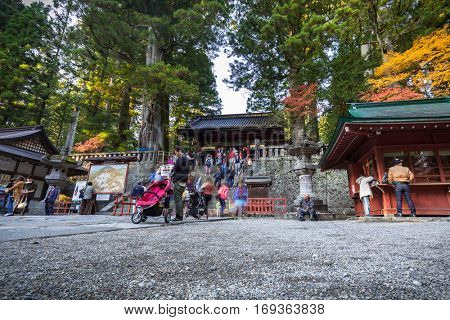 NIKKO, JAPAN - NOVEMBER 13, 2016: Tourists at Toshogu Shrine temple in Nikko, Japan. Nikko is a popular destination for many international tourists with Tosho-gu temple, a UNESCO World Heritage Site.