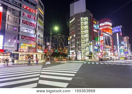TOKYO, JAPAN - NOVEMBER 13, 2016: Crosswalk at Ikebukuro district of Tokyo metropolis at night, Japan. Tokyo Metropolis is both the capital and most populous city of Japan.