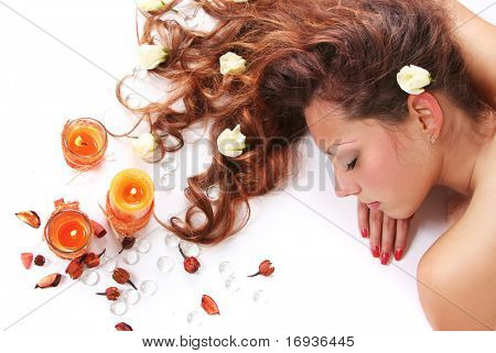 beautiful long-haired girl relaxing in spa salon poster