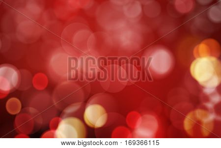Abstract bokeh background in shades of red and dark red with blown out, blurred red golden light dots. Festive look and great for romantic occasions.
