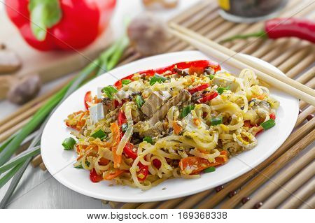 Asian meal made of rice noodles tofu vegetables and shiitake mushrooms. Traditional Oriental cuisine meal.