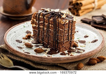 Delicious sweet chocolate Spartak cake on a rustic plate. Haute cuisine dessert. International food.
