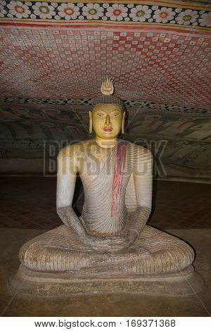 DAMBULLA, SRI LANKA - MARCH 14, 2015: Ancient sculpture of a seated Buddha in one of the first Buddhist cave temples of Ceylon. Dambulla, Sri Lanka