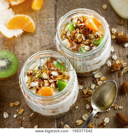 Delicious healthy American breakfast made of granola yogurt and fruits. Classic US morning meal. Traditional healthy snack. Top view.