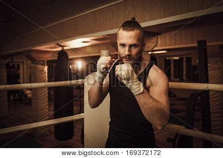 Fighter shadowboxing on training ring