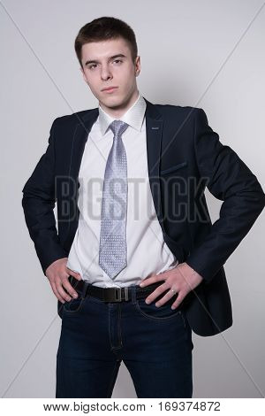 Portrait Of Serious Young Businessman Hands On His Belt