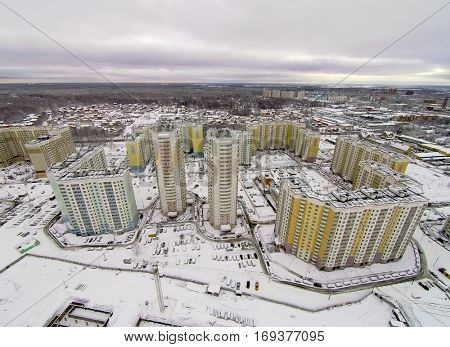 Aerial view of multi-storey houses district at winter