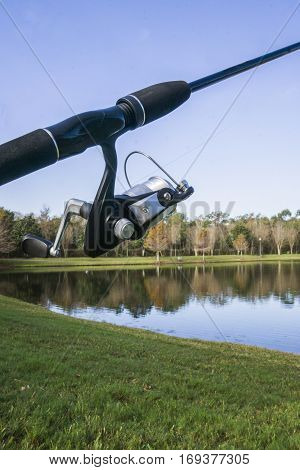 Rod and reel at a pond during the morning